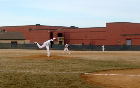 Austin Blazevik, left, pitches from the mound at the April 1 game against Morris. The Plainfield boys won 6-3.