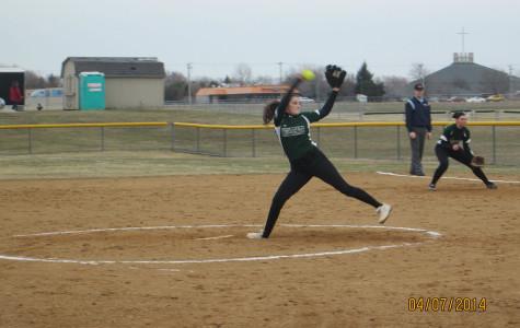 Girls' softball rallies at home base
