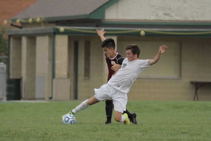 Junior Jarod Petrovic slides to keep the ball from a Plainfield North opponent.