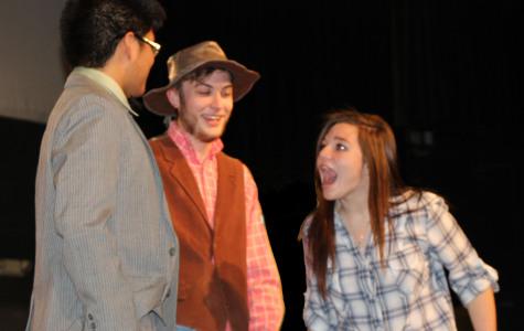 Sheldon Ticala sophomore, Tyler Kauffmen junior,  and Mary Crushing senior preform a scene in Beverly Hillibillies, opening on Nov. 13 at 7:30p.m.