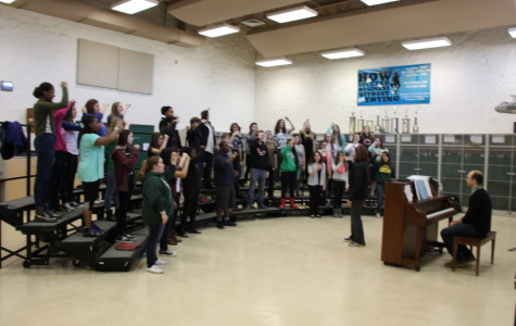 Alanna Fredrickson helps students improve for the upcoming show. Choir students have worked very hard to preform in concerts.