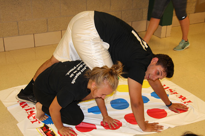 Freshmen students played twister as one of the many games featured during the Freshmen Mixer.