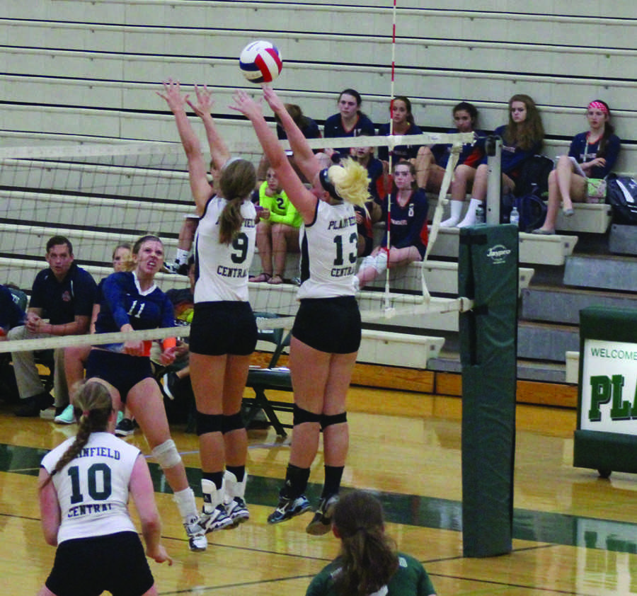 Juniors+Ashley+Shook+and+Kory+Beard+block+a+spike+from+Oswego+East.