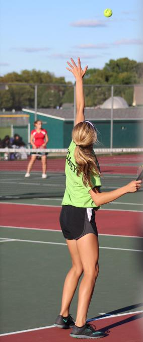 Senior Kirsten  Kissel serves against Bolingbrook in her winning match on Wednesday, Sept. 30. The team has qualified five players for  sectionals:  Seniors Viona Lugo, Delaney Starkman, Tia Slove, Nicole Cundari, and junior Katie Karneay.