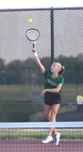 Sophomore, Katie Kearney serves to her opponent in her win vs.  Plainfield South.