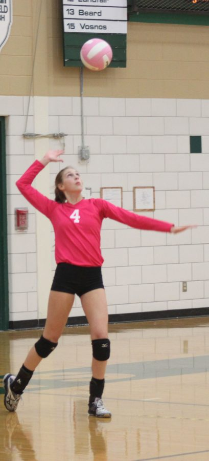 Sophomore%2C+Grace+Brock+serves+the+ball+in+a+win+against+Minooka.