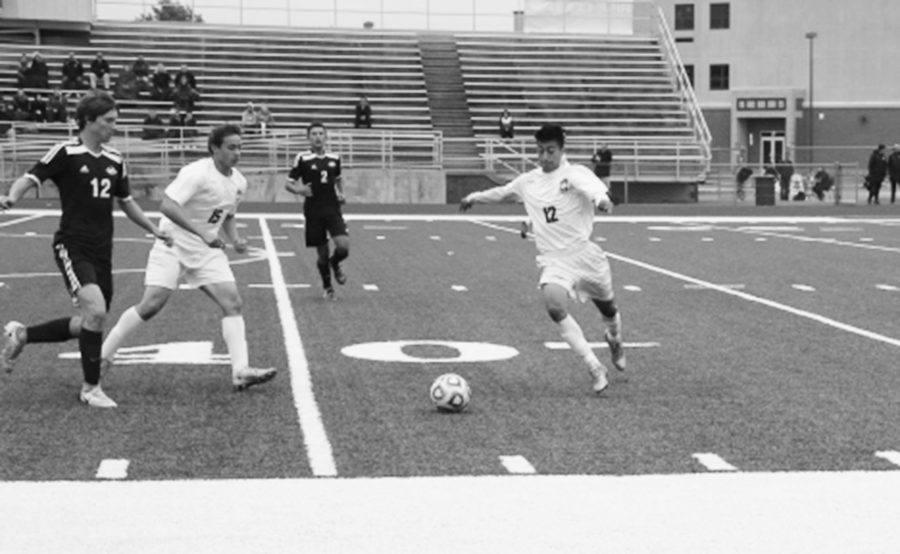 Sophomore Sebastian Contreras kicks the ball past defenders in their win vs. Plainfield South on October 15.