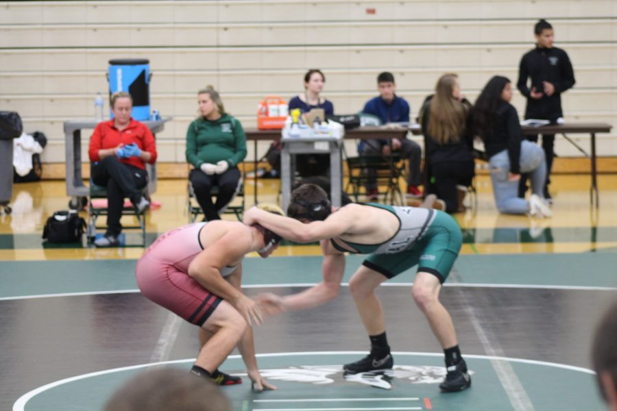 Joshua Mackenzie, junior, tries to take down his opponent in the tournament against Plainfield North on Dec 1