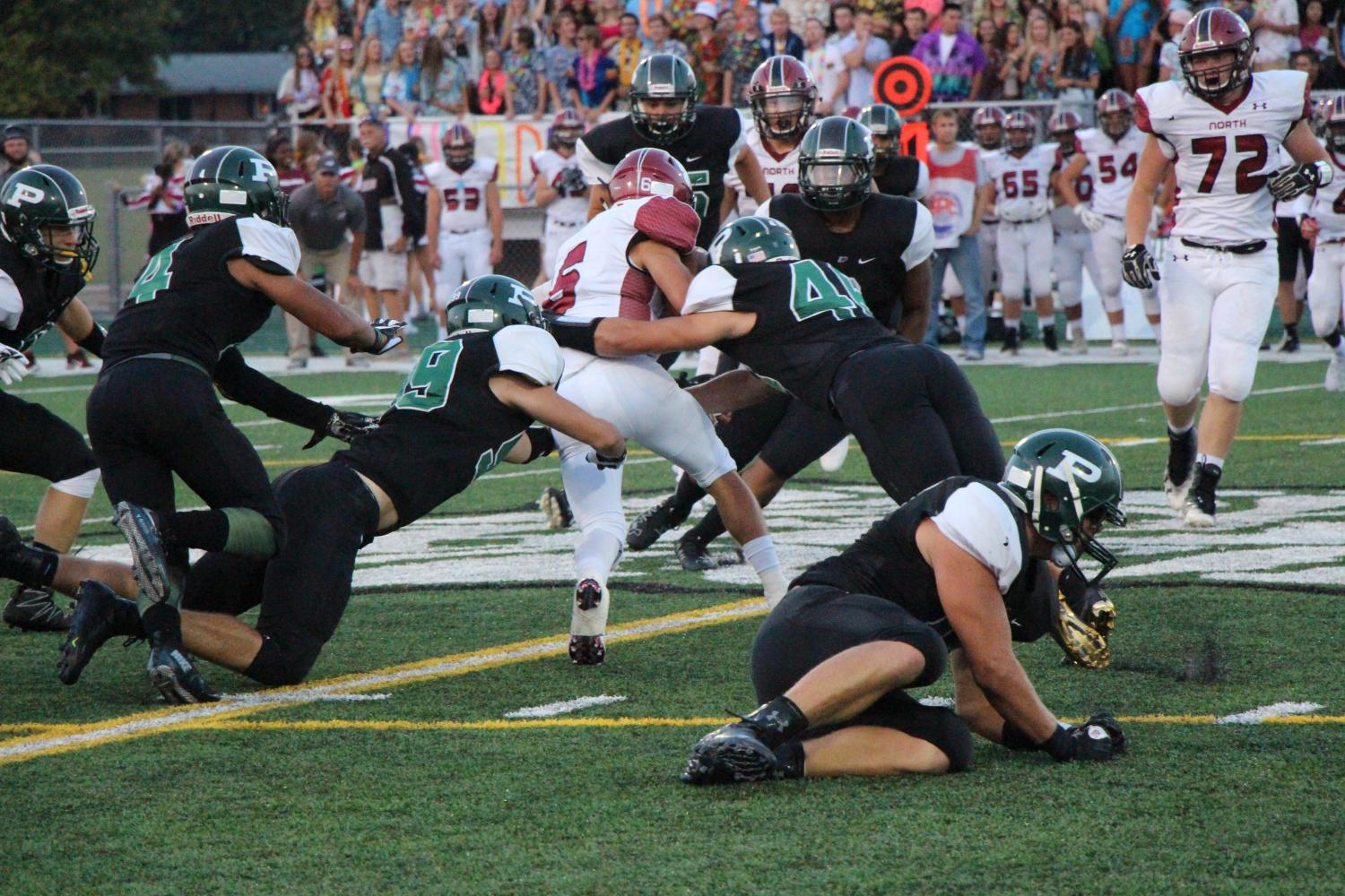 Ethan Dominguez, junior,  makes a succesful tackle against Plainfield North's player in their first game on Friday,  Sept. 1.  The wildcats lost 7-21.