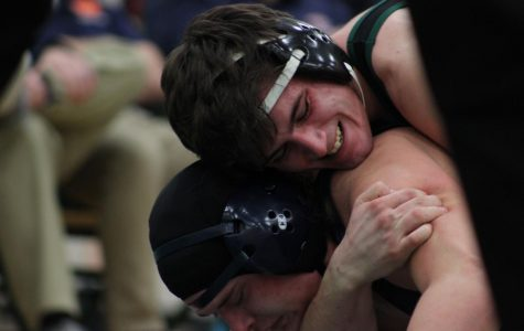 Wrestling advances 3 to state