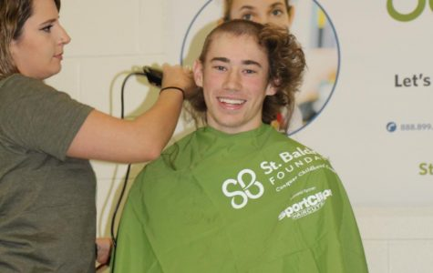 Students shave heads to support cancer research