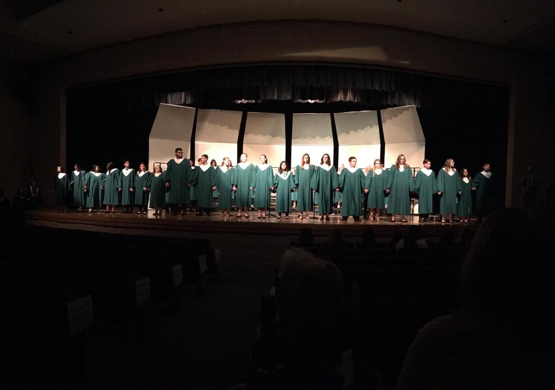 Senior choir members stand in recognition at their last choir concert on Tuesday, May 8th.