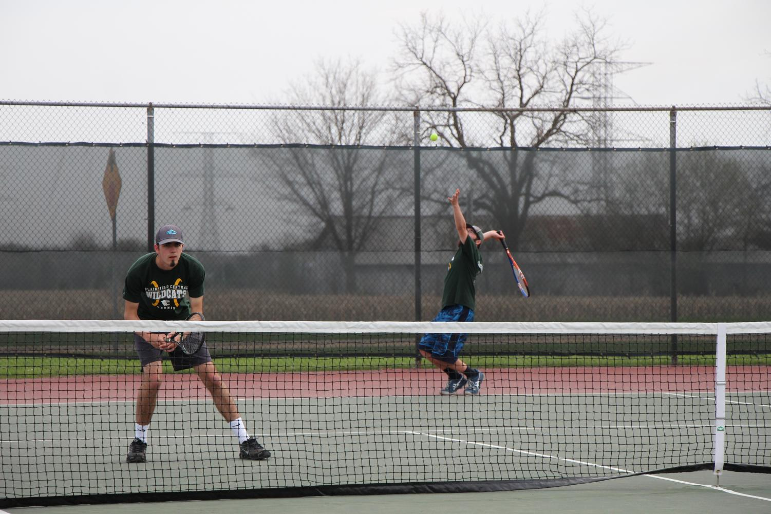 Senior Sam Jackson prepares for the return as his partner, senior Noah Bylon serves.