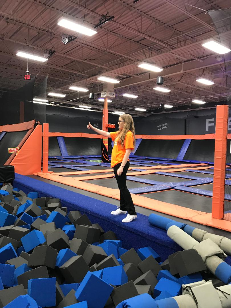Junior Juliette Hop monitors the joust court at her job at Sky Zone in joliet.