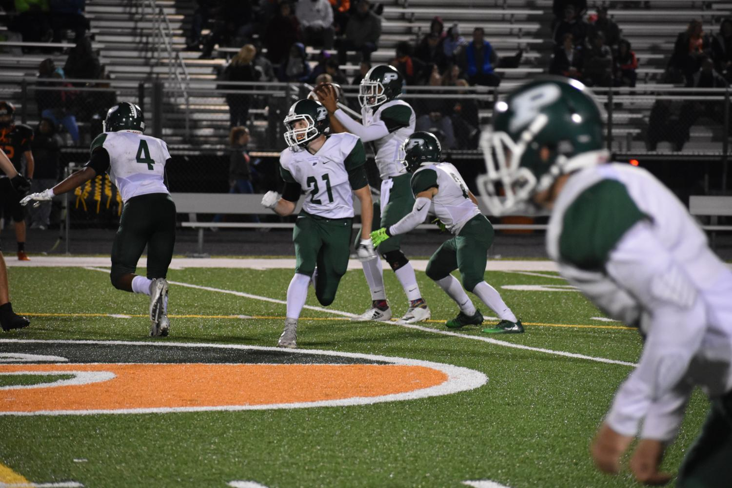 Senior Justin Lentz, #21, runs a route to get open to receive a pass from quarterback Nick Barner, senior.