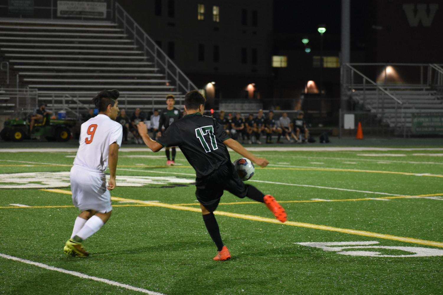 Sophomore Berto Centeno steals the ball from the Romeoville player in their 1-0 victory on Oct. 9.