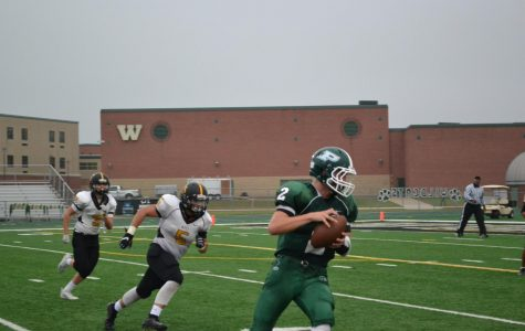 JV Quarterback Nathan Buchan, sophomore, looks for an open receiver.