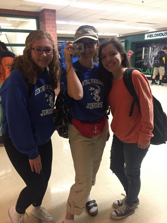 (From left to right) Danielle Williams and Kyra Kohlstedt, juniors, and Emily Flores, senior, dressed for powderpuff class color and tacky tourist