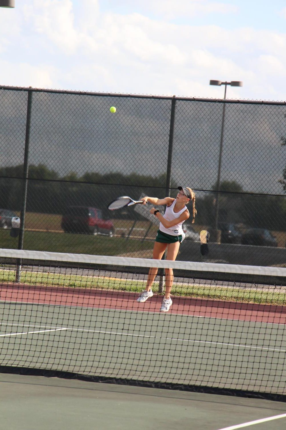 Senior Katie Kearney serves to Romeoville during the last home match of the season. The Wildcats won 7-0.