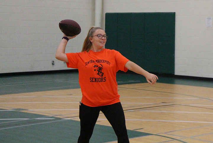 Senior Jianna Bocconcelli throws a football for her PE class. Students also have the opportunity to participate in Fit Club on Tuesdays and Thursdays to try out different activities and sports.