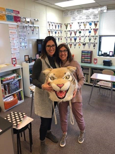 Julie+Banholzer%2C+counselor%2C+passes+the+Wildcat+award+to+Karen+Seeberg%2C+ELL+teacher.