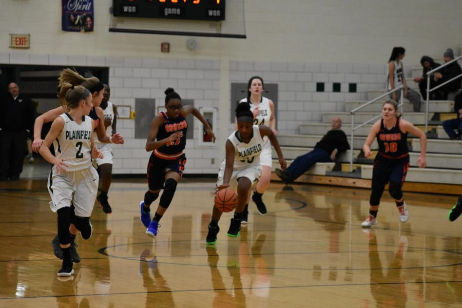 Kachae Donald, junior, brings the ball down the court to set up the offense against Oswego.  The Wildcats  lost 52-72.