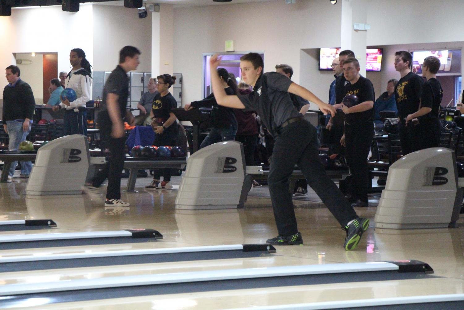 Sophomore Mason Craig bowls during the tournament against Joliet West on Tuesday, Dec. 11.  The team       obtained 2 out of 10 points, winning only the last game.