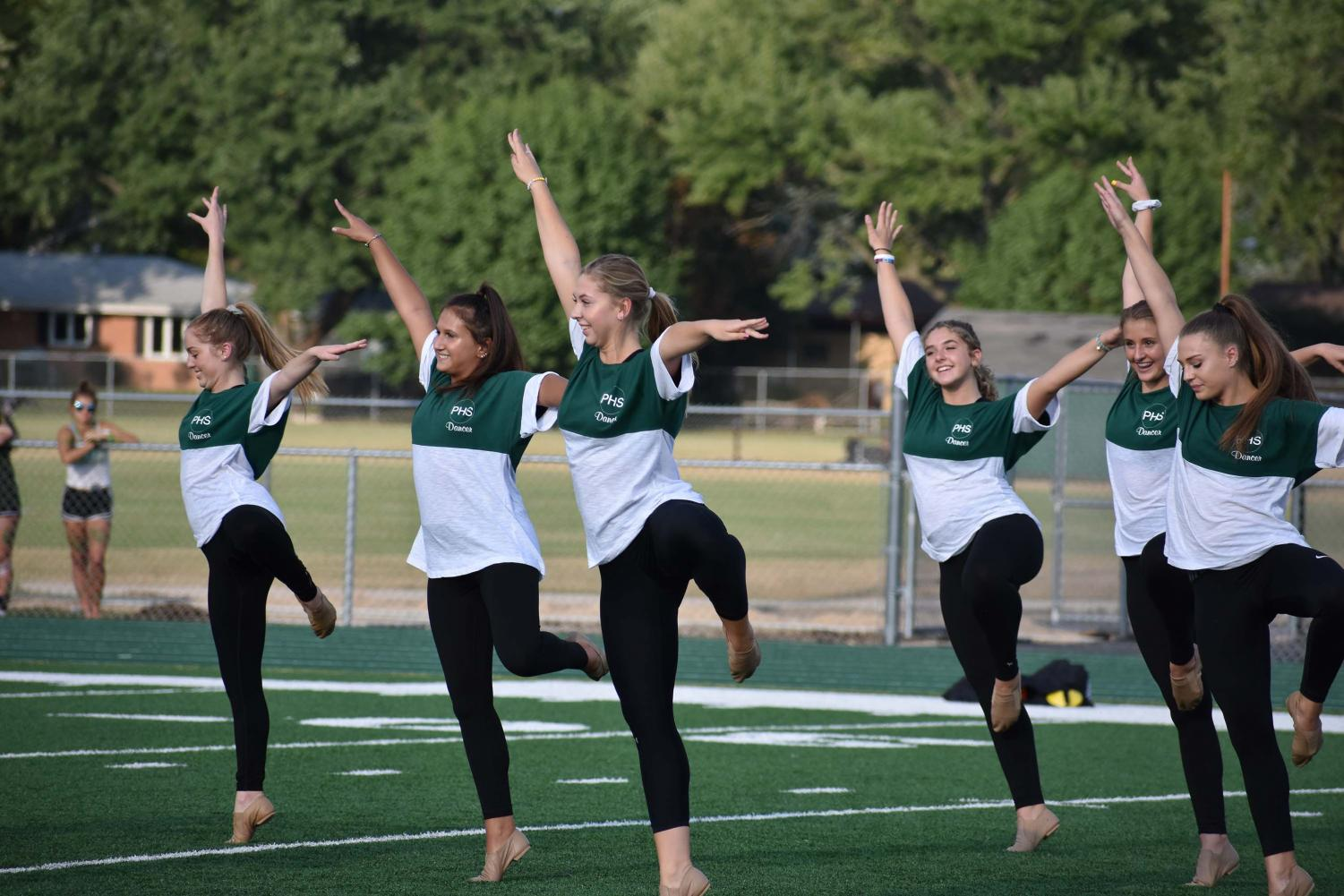 Sophomore+Emma+Rivecco%2C+seniors+Madison+Rambo+and+Olivia+Arriaga%2C+sophomores+Elise+Arriaga+and+Kayla+Dvorak%2C+and+junior+Jenna+Obman+hold+their+legs+in+pique+during+the+poms+routine.
