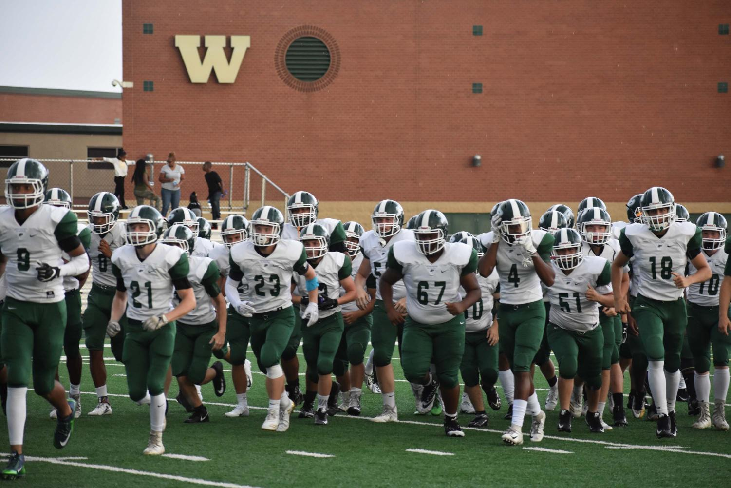 The+varsity+football+team+takes+the+field+fresh+off+summer+training.+The+team+broke+their+four-year+losing+streak+last+year+in+a+close+game+with+Plainfield+East.
