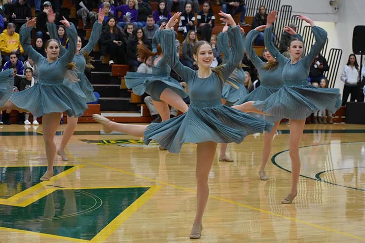 Sophomore Ella Majewski completes a la seconde turn in the team's lyrical routine.