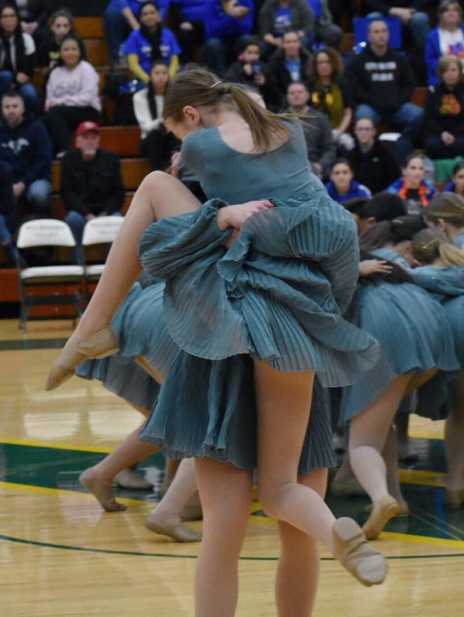 Senior Paige Ekblad and junior Jenna Obman embrace at the end of the dance.