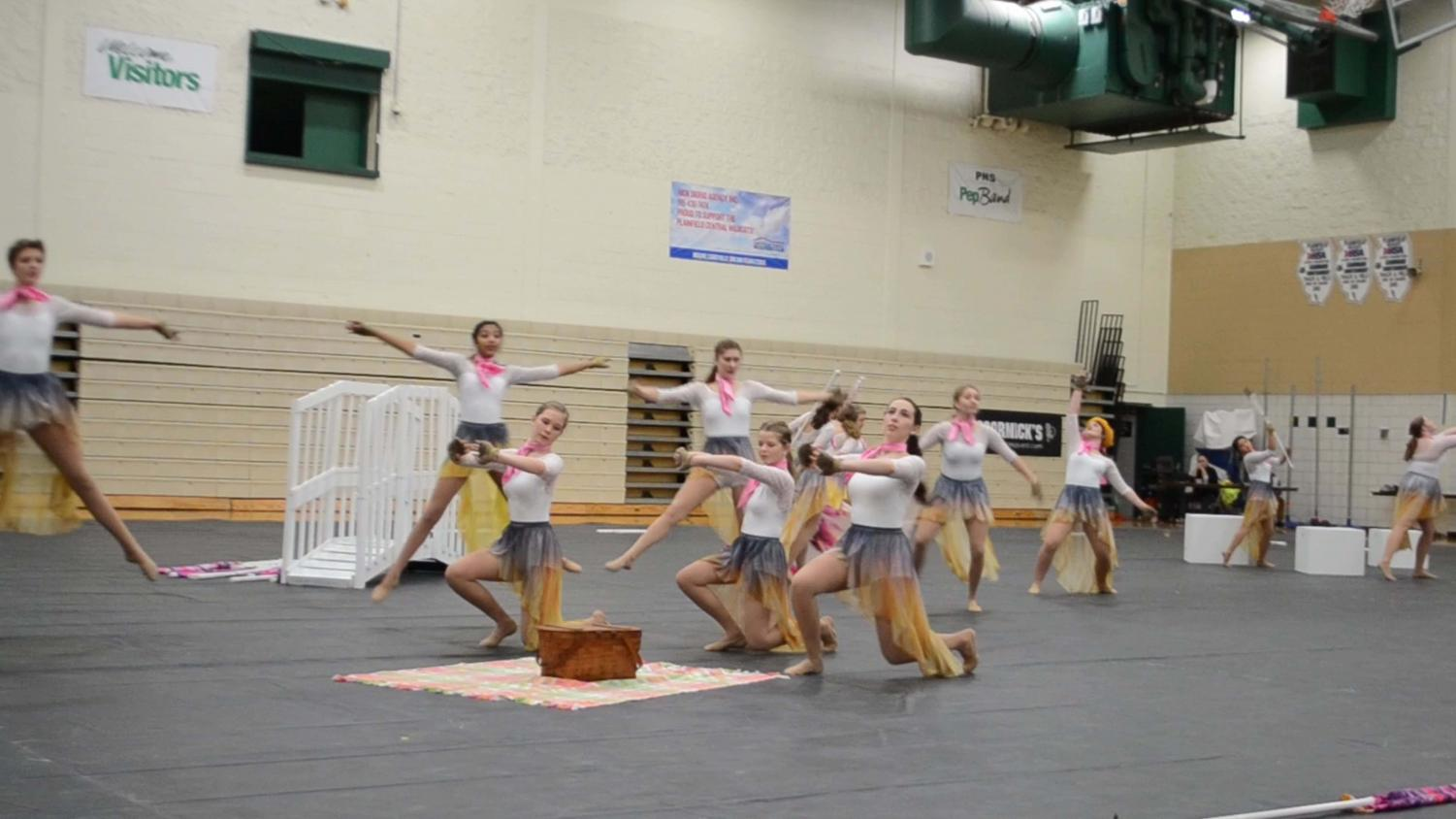 Members of Downers Grove North winter guard perform their routine in the main gym on Sunday, Feb. 3rd for the winter guard festival.