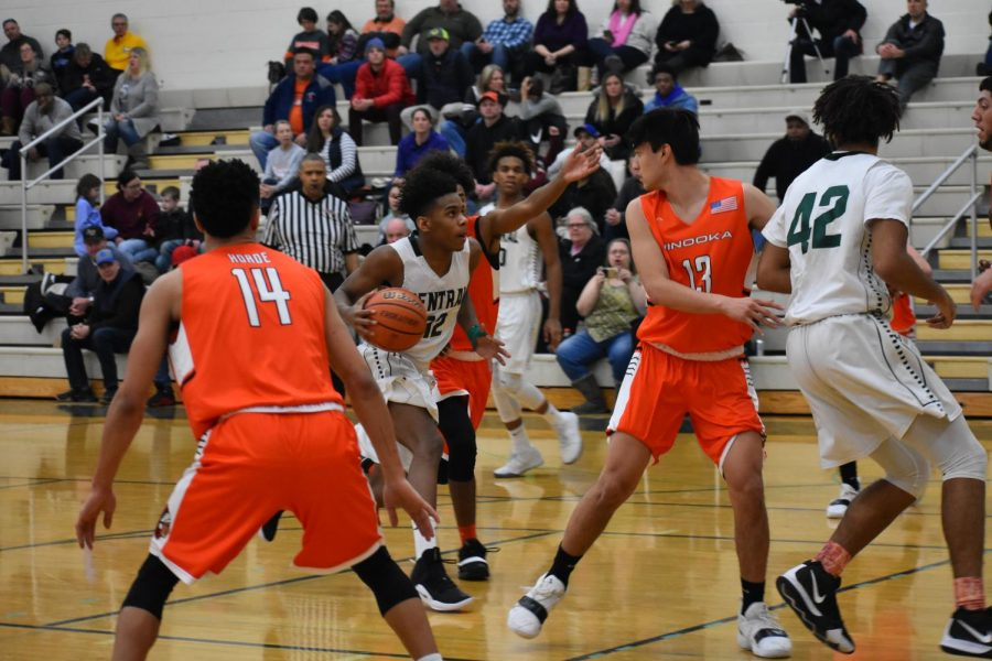 Junior+Tavari+Johnson+drives+to+the+basket+through+Minooka%E2%80%99s+defense.+The+Wildcats+won+58-56.
