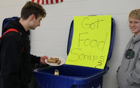 Senior Cole Schreiber deposists his food scraps in the compost bin. Only two of the four Plainfield high schools are participating in the pilot program.