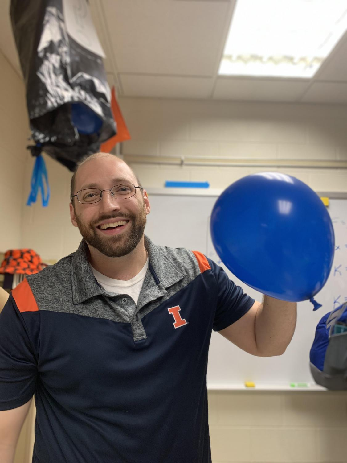Ben Nugent, physics teacher, announced the gender of his third child by cutting open a bag of blue balloons.