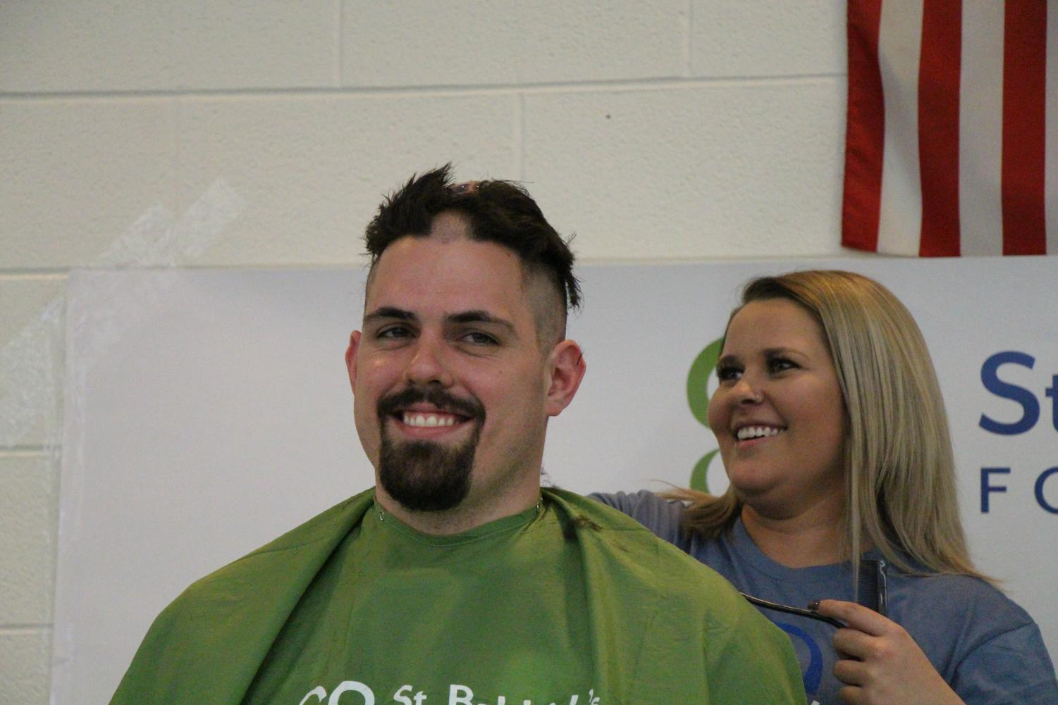 Jon Pereiro, teacher, was shaved down the center of his head, much to the amusement of the audience.