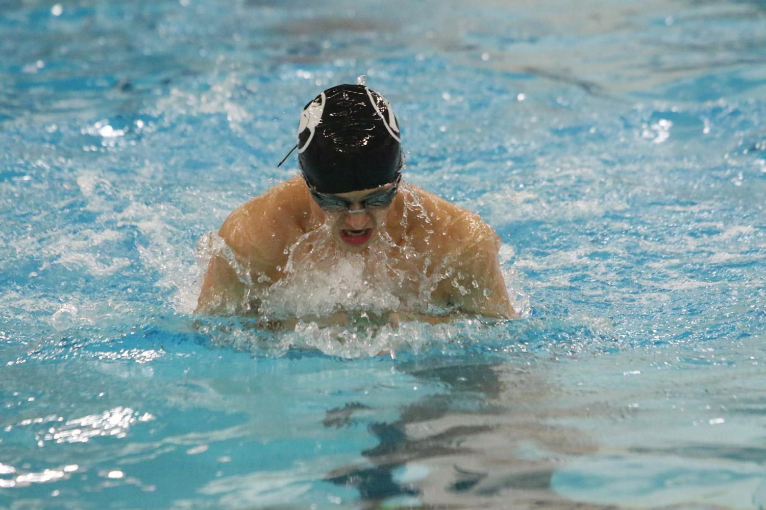 Senior Alec Danko surfaces to take a breath during the 100 yard breast stroke race.