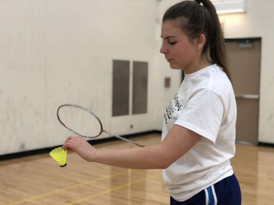 Senior Andrea Heagney warms up her serve during practice. Their first game is on March 19.