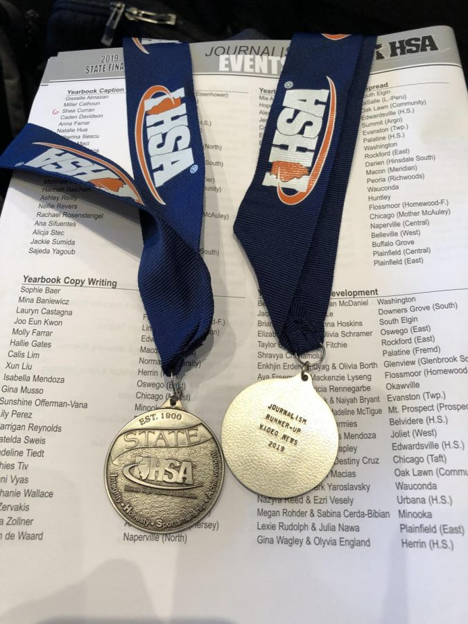 Paige Gieske, junior, and Jude Mendoza, senior, earned these silver medals for their news video on the Hawkapalooza music event held at Heartland College on Friday, April 26.