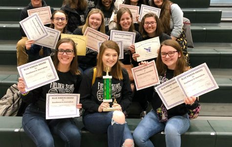 Staff brings home NISPA Golden Eagle award