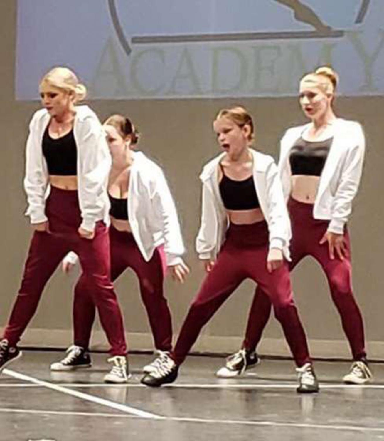 Freshman Katelynn Gazda, second from right,  performes a hip-hop  routine with her out of school dance  troupe