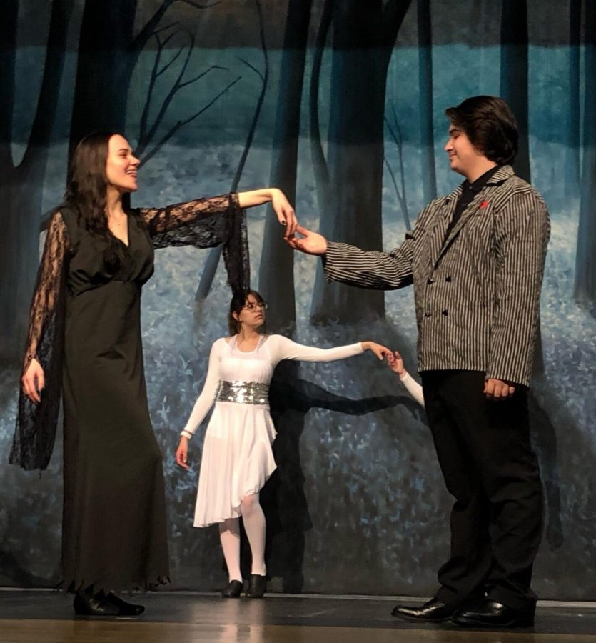 Sydney Schillinger, junior, and Joseph Sarabia, sophomore, share a tender moment on stage; they play Morticia and Gomez respectively.  Photo by Paige Gieseke