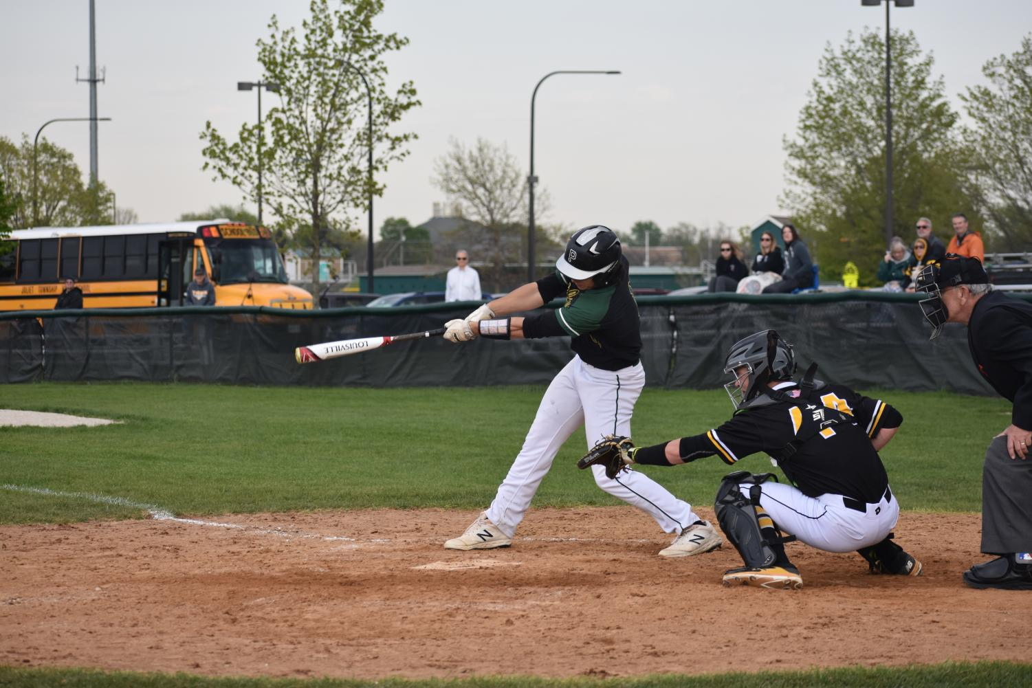 Junior Brandon Micetech connects with the pitch. He has commited to Eastern Illinois University to play baseball.