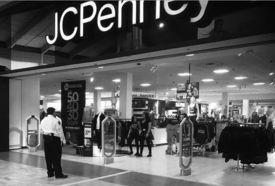 A mall security guard supervises JCPenneys, preventing the youth from entering past 5 p.m. on a Friday.