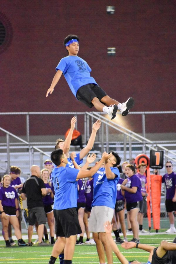 Christian DeLeon, senior, flies in the air during halftime as a stunt rehearsed by the boys. As a time for students to have fun and participate in school spirit, the boys put on a show for students, faculty, and families.