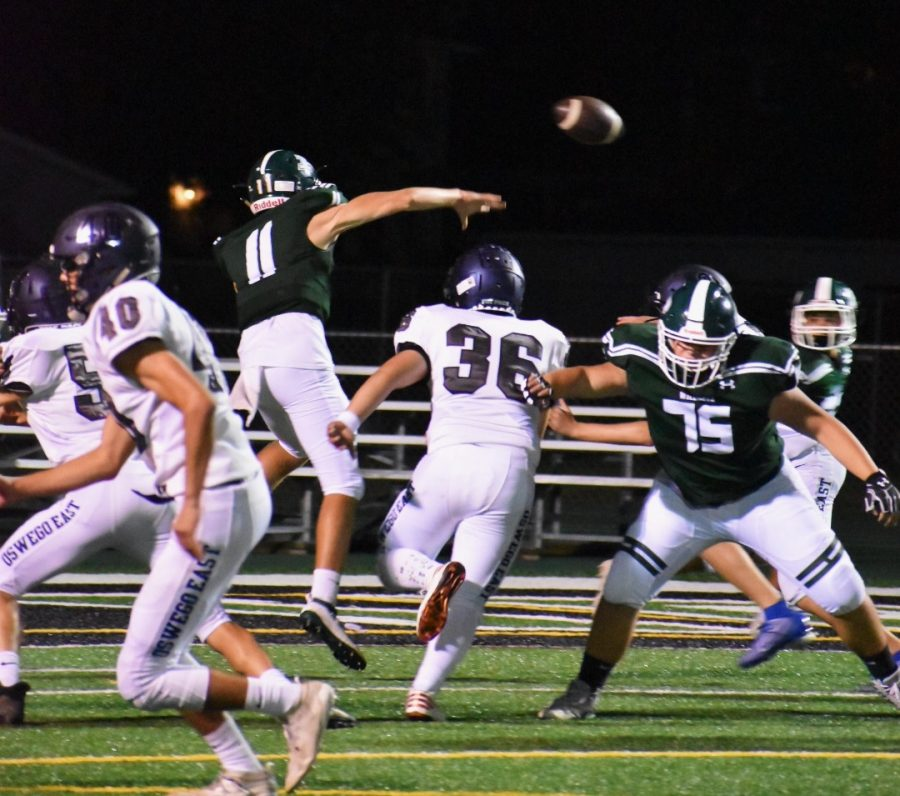 Quarterback+Chris+Leto+%28%2311%29%2C+junior%2C+throws+a+pass+to+his+teammates+in+their+loss+against+Oswego+East+7-55+on+Sept.+6.+