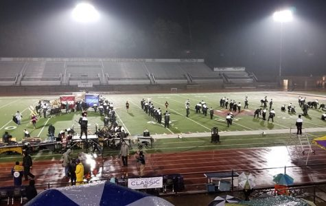 The Wildcat Marching Band prepares to perform in competition at Western Illinois University on Oct 26.