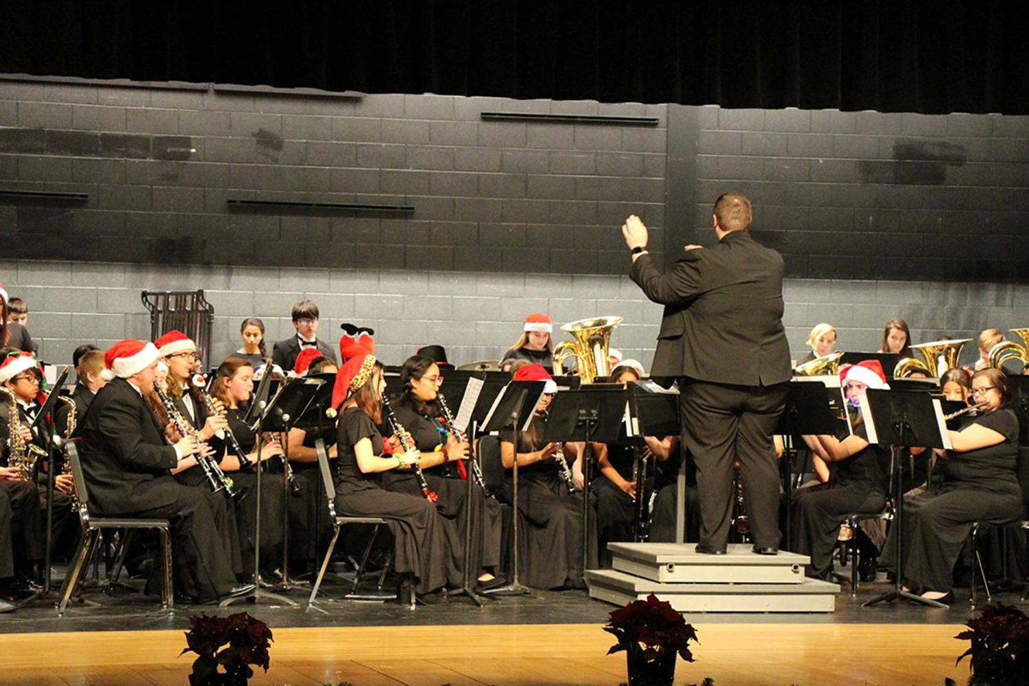 Student aid director, Marc Smith, conducts the Symphonic band ensemble in a medley of John William's Home Alone soundtrack.