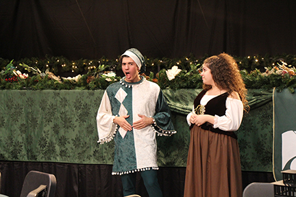 Junior Brayden Ruland, Jester, and senior Nicole Zaknoun, Wench, entertain the audience with comedic commentary. The cast performs Dec. 13 - Dec. 14 in the auditorium.