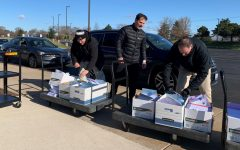 (From left) District 202 Superintendent Dr. Lane Abrell, Dave Stephens, Plainfield High School-Central Campus principal, and Dr. Glenn Wood, Assistant Superintendent of Curriculum and Instruction hand out Remote Learning packets to families on Monday, March 30, 2020 at the Administration Center, 15732 S. Howard St.